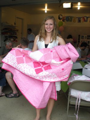 Erin and the quilt that Corinne's mom made for her. Pretty flippin' fantastic.